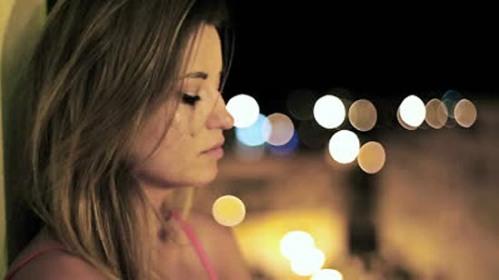 stock-footage-beautiful-sad-woman-crying-in-the-night